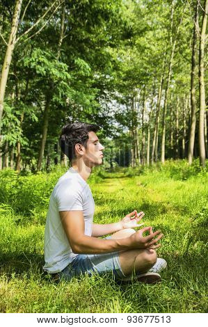 Young Man Meditating or Doing Outdoor Yoga Exercise