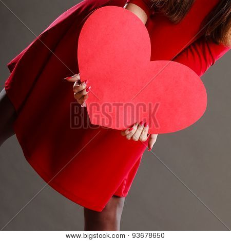 Girl Holding Big Red Heart In Hands