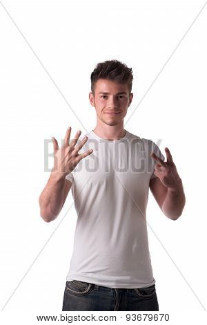 Handsome young man counting to seven 7 with fingers and hands