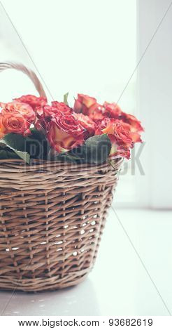 roses in a basket on the table