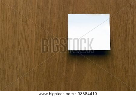 Paper Note Against Wooden Surface.