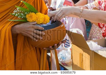 Buddhist Monk While Stand In A Row Waiting People Put Rice Offerings In Their Alms Bowl .