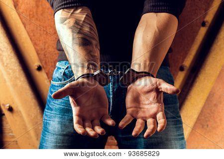 Tattooed Hands Of A Criminal Handcuffed