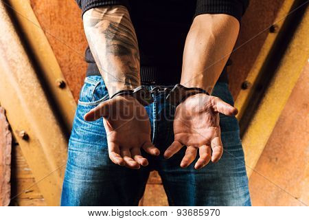 Tattooed Hands Of A Criminal Handcuffed