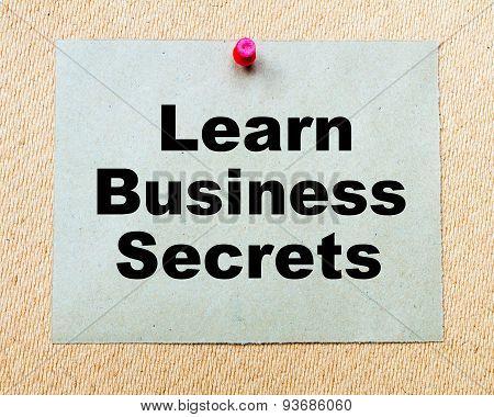 Learn Business Secrets  Written On Paper Note