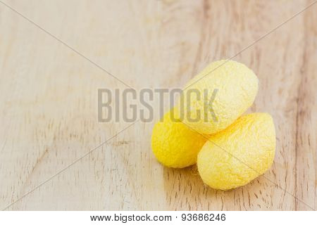 Silkworm Cocoon On Wood Background.