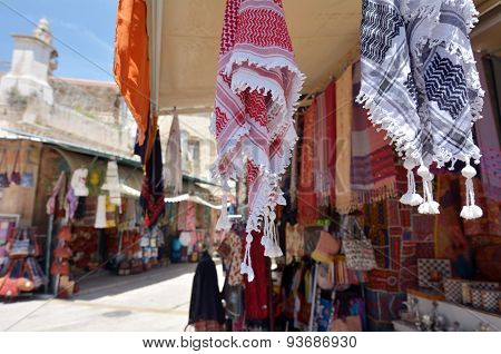 Arab keffiyeh on display in a store at the Arab market of the old city Jerusalem Israel.