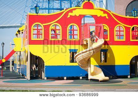 Little Kid On Children's Slide