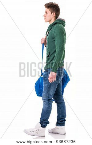 Attractive young man with bag on shoulder strap, isolated