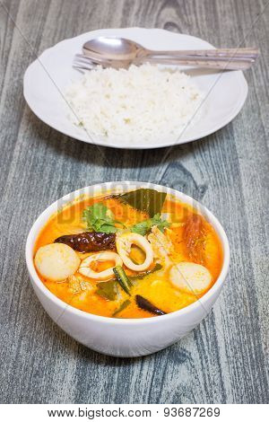 Tom Yum Kung-thai Spicy Soup With Thai Jasmine Rice On Wood Background