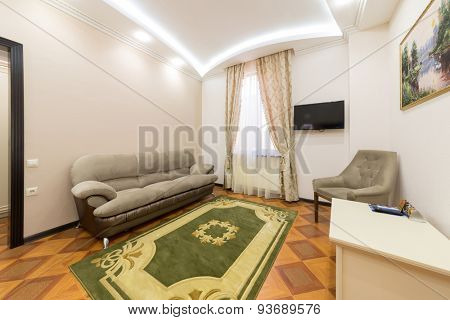 ADLER, RUSSIA - JULY 22, 2014: Interior of a hotel room with sofa, chair and carpet in Shine House hotel