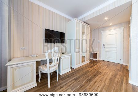 ADLER, RUSSIA - JULY 21, 2014: table TV and a wardrobe in a hotel room in El Paraiso hotel