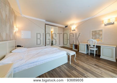 ADLER, RUSSIA - JULY 21, 2014: Interior of a hotel room with beds table and wardrobe in El Paraiso hotel