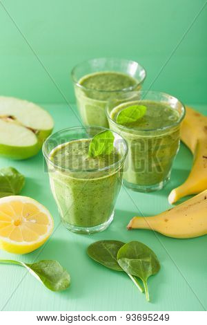 healthy green smoothie with spinach leaves apple lemon banana