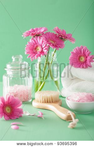 spa aromatherapy with gerbera flowers herbal salt  brush