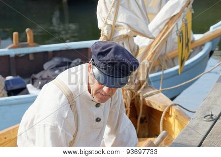 Old Male Sailor In Vintage Clothes Preparing Old Sailing Ship