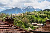 foto of chapels  - Bulgarian mountain village small chapel and snow mountain in the distance - JPG