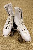 stock photo of roller-skating  - Old worn roller skates with big shoe - JPG