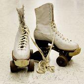 pic of roller-skating  - Old worn roller skates with big shoe - JPG