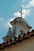 stock photo of medellin  - A steeple with a cross on top and two bells in Medellin Colombia - JPG