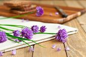 pic of chive  - Fresh chives and organic rye bread in background selective focus - JPG