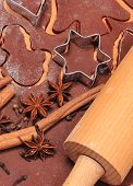 image of christmas spices  - Spice for baking anise cinnamon cloves cookie cutters and rolling pin on dough for gingerbread concept for baking and christmas time - JPG