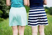 picture of short skirt  - Girls in short cotton skirts shot from behind summer feeling - JPG