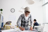 picture of draft  - Stylish Vietnamese architect making draft in the office - JPG