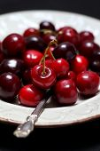 foto of black-cherry  - Ripe sweet cherries on a black background - JPG