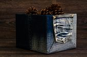 picture of pine cone  - Dry pine cones in denim box on brown wooden table - JPG