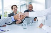 stock photo of interview  - Interview panel shaking hands with applicant in the office - JPG
