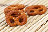stock photo of pretzels  - Salty pretzels on bamboo surface - JPG