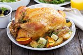 foto of roast chicken  - Whole roasted chicken with potatoes on dinner table - JPG