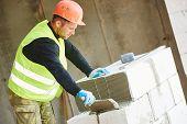 image of bricklayer  - Bricklaying work - JPG