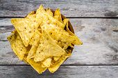 image of nachos  - nachos corn chips in a bowl on a wooden table - JPG