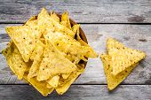picture of nachos  - nachos corn chips in a bowl on a wooden table - JPG