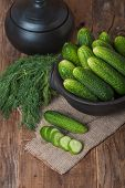 picture of cucumber slice  - Fresh cucumbers and slices on a wooden table - JPG