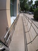 pic of distort  - Ramp for physically challenged from the tiled pavement with wide angle fisheye lens and distortion view - JPG