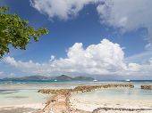 stock photo of cumulus-clouds  - Beautiful seascape with blue sea cumulus clouds stones and yachts in the distance Seychelles - JPG