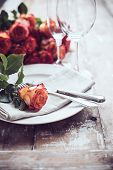 image of wedding table decor  - Vintage table setting with glasses and cutlery on an old wooden board - JPG