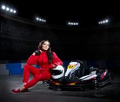 picture of karts  - Young girl karting racer at stadium - JPG