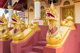 pic of serpent  - Serpent in the building in front of the entrance to the temple - JPG
