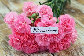 image of carnation  - Welcome home card with pink carnations on rustic wooden surface - JPG