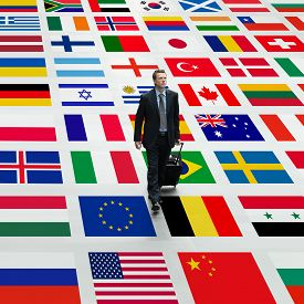 picture of flags world  - business man travels the world walking on a background of international flags - JPG
