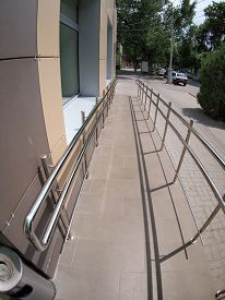 picture of distort  - Ramp for physically challenged from the tiled pavement with wide angle fisheye lens and distortion view - JPG