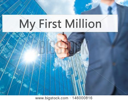 My First Million - Businessman Hand Holding Sign