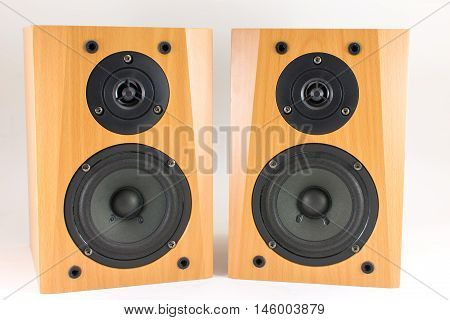Wooden Stereo Speakers On White