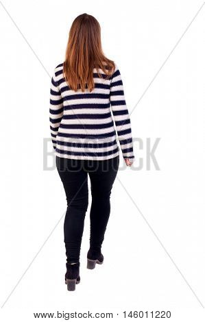 back view of walking woman. Girl in a striped jacket leaves the frame.