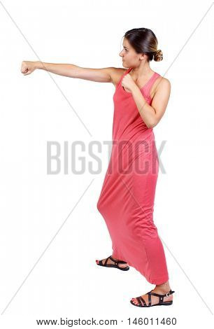 skinny woman funny fights waving his arms and legs. A slender woman in a long red dress fulfills hands.
