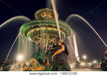 Place de la Concorde by night close up of the fountains Paris. Horizontal shot